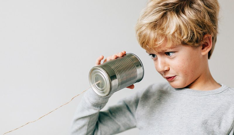 Boy looking into makeshift phone