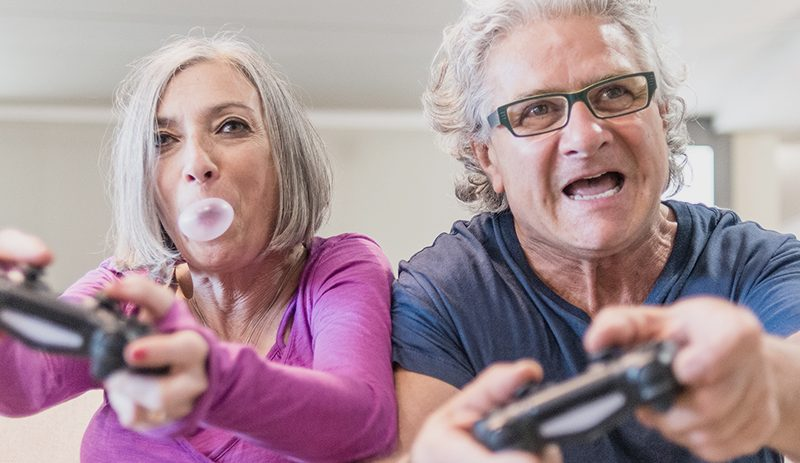 Retired couple playing video games
